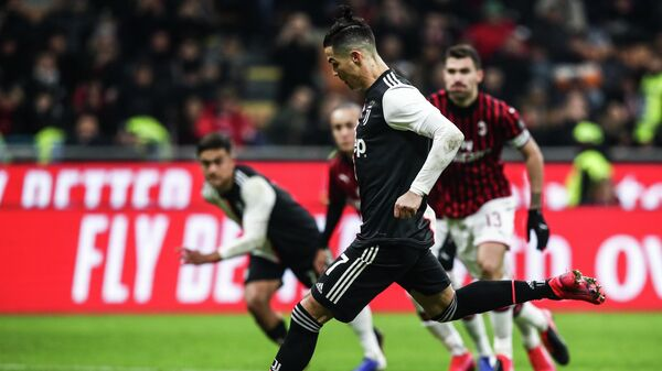 Juventus' Portuguese forward Cristiano Ronaldo shoots to score a penalty and equalize during the Italian Cup (Coppa Italia) semi-final first leg football match AC Milan vs Juventus Turin on February 13, 2020 at the San Siro stadium in Milan. (Photo by Isabella BONOTTO / AFP)