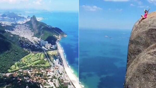Кадры видео туристки, позирующей на скале Педра-да-Гавеа в Рио-де-Жанейро