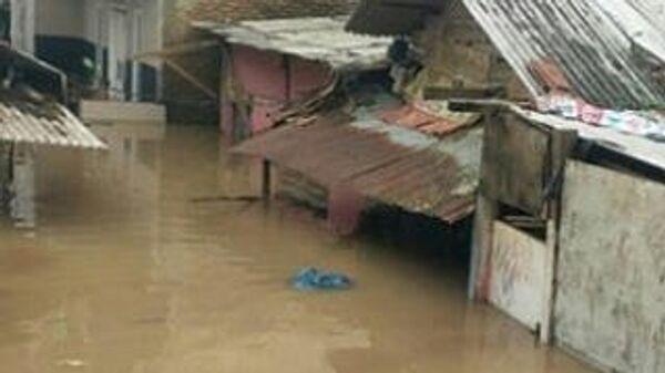 Наводнение в районе Крамат Джати в Восточной Джакарте