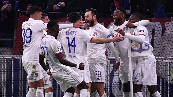 Lyon's French midfielder Lucas Tousart (C) celebrates with teammates after scoring a goal  during the UEFA Champions League round of 16 first-leg football match between Lyon and Juventus at the Parc Olympique Lyonnais stadium in Decines-Charpieu, central-eastern France, on February 26, 2020. (Photo by FRANCK FIFE / AFP)