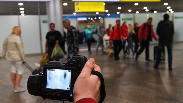 Дистанционная термометрия авиапассажиров, прибывших из-за границы