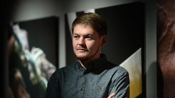 Фотокорреспондент Алексей Филиппов, занявший первое место в номинации Спорт с серией фотографий На кончиках пальцев