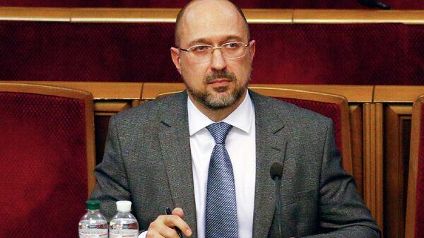 Премьер-министр Украины Денис  на внеочередном заседании Верховной рады Украины в Киеве
