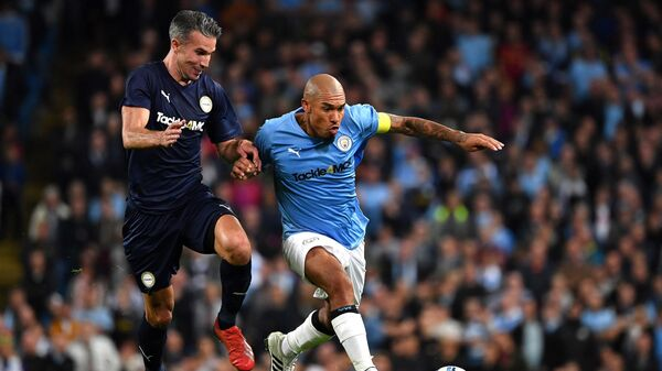 Premier League All-stars XI's Dutch striker Robin van Persie (L) Manchester City Legend's Dutch midfielder Nigel de Jong during the Vincent Kompany testimonial football match between the Manchester City Legends and the Premier League All-stars XI at the Etihad Stadium in Manchester, northwest England, on September 11, 2019. (Photo by Paul ELLIS / AFP)