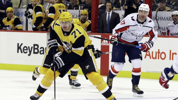 Mar 7, 2020; Pittsburgh, Pennsylvania, USA;  Pittsburgh Penguins center Evgeni Malkin (71) carries the puck against the Washington Capitals during the third period at PPG PAINTS Arena. Washington won 5-2. Mandatory Credit: Charles LeClaire-USA TODAY Sports