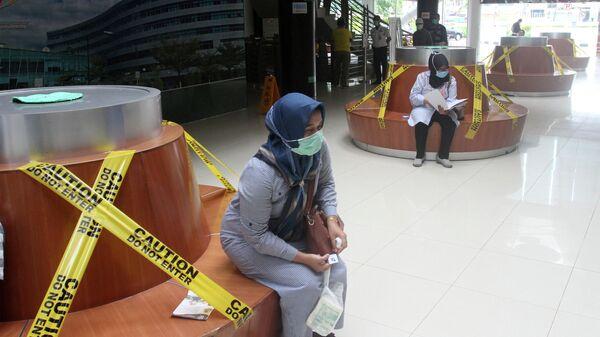 Посетители в больнице в Паданге, провинция Западная Суматра, Индонезия