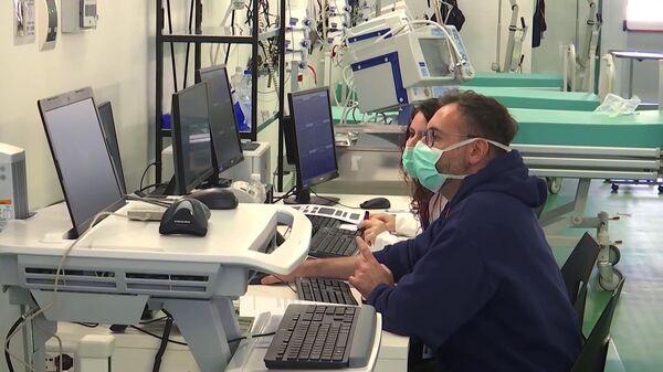 Полевой госпиталь в Бергамо, в котором российские и итальянские специалисты в круглосуточном режиме будут принимать, диагностировать и лечить заболевших коронавирусом COVID-19