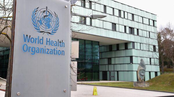 Логотип Всемирной организации здравоохранения (ВОЗ) здания в Женеве