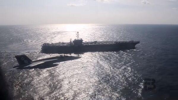 Опубликовано видео полета российского Ил-38 возле американского авианосца