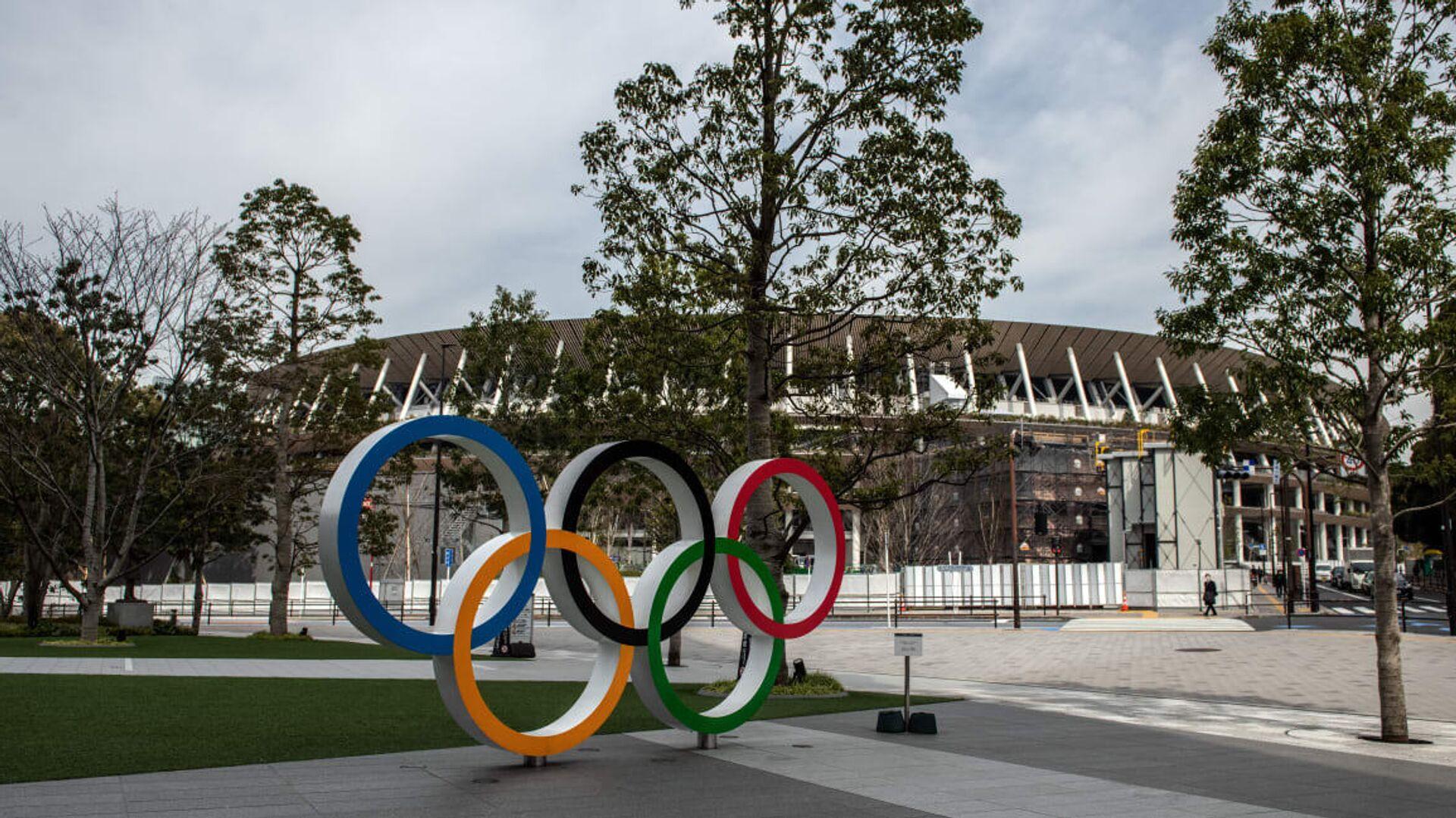 Олимпийские кольца у арены в Токио - РИА Новости, 1920, 02.12.2020