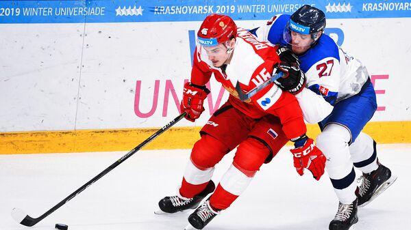 Игорь Руденков (слева)