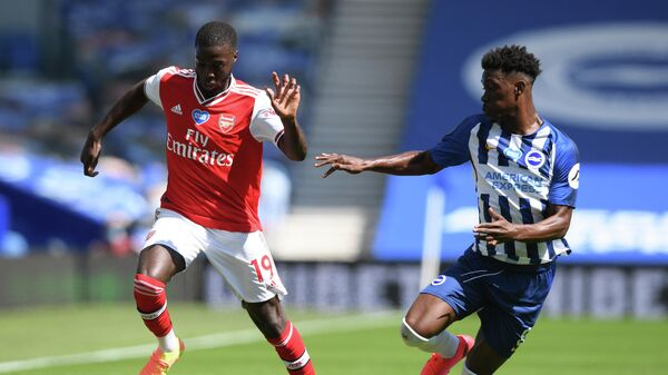Arsenal's French-born Ivorian midfielder Nicolas Pepe (L) and Brighton's Ivorian midfielder Yves Bissouma compete during the English Premier League football match between Brighton and Hove Albion and Arsenal at the American Express Community Stadium in Brighton, southern England on June 20, 2020. (Photo by Mike Hewitt / POOL / AFP) / RESTRICTED TO EDITORIAL USE. No use with unauthorized audio, video, data, fixture lists, club/league logos or 'live' services. Online in-match use limited to 120 images. An additional 40 images may be used in extra time. No video emulation. Social media in-match use limited to 120 images. An additional 40 images may be used in extra time. No use in betting publications, games or single club/league/player publications. /