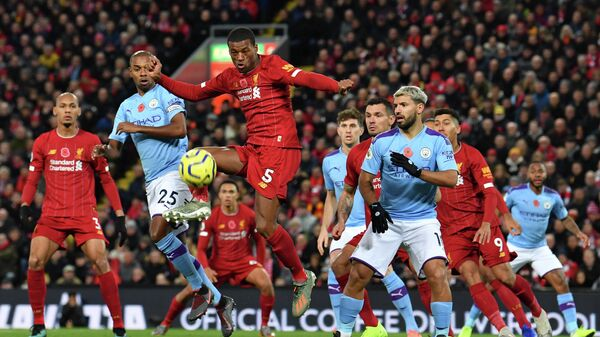 Liverpool's Dutch midfielder Georginio Wijnaldum (C) controls the ball during the English Premier League football match between Liverpool and Manchester City at Anfield in Liverpool, north west England on November 10, 2019. (Photo by Paul ELLIS / AFP) / RESTRICTED TO EDITORIAL USE. No use with unauthorized audio, video, data, fixture lists, club/league logos or 'live' services. Online in-match use limited to 120 images. An additional 40 images may be used in extra time. No video emulation. Social media in-match use limited to 120 images. An additional 40 images may be used in extra time. No use in betting publications, games or single club/league/player publications. /