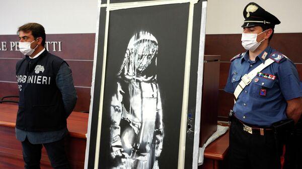 Похищенная работа британского художника Бэнкси, посвященная жертвам террористической атаки в клубе Bataclan в Париже, которую нашли итальянские полицейские