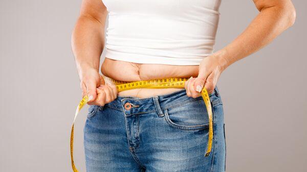 Женщина с лишним весом