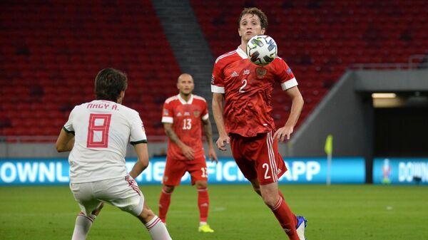 Защитник сборной России Марио Фернандес (справа)