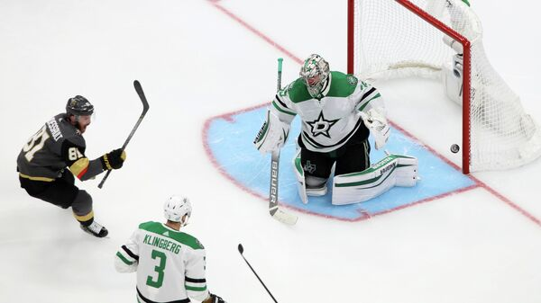 Sep 14, 2020; Edmonton, Alberta, CAN; Vegas Golden Knights center Jonathan Marchessault (81) scores a goal past Dallas Stars goaltender Anton Khudobin (35) during the third period in game five of the second round of the 2020 Stanley Cup Playoffs at Rogers Place. Mandatory Credit: Gerry Thomas-USA TODAY Sports