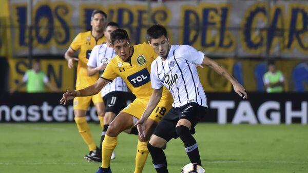 Науэль Молина (слева)