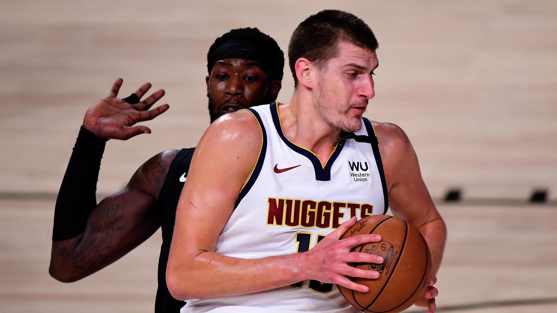 LAKE BUENA VISTA, FLORIDA - SEPTEMBER 15: Nikola Jokic #15 of the Denver Nuggets drives the ball against Montrezl Harrell #5 of the LA Clippers during the first quarter in Game Seven of the Western Conference Second Round during the 2020 NBA Playoffs at AdventHealth Arena at the ESPN Wide World Of Sports Complex on September 15, 2020 in Lake Buena Vista, Florida. NOTE TO USER: User expressly acknowledges and agrees that, by downloading and or using this photograph, User is consenting to the terms and conditions of the Getty Images License Agreement.   Douglas P. DeFelice/Getty Images/AFP - РИА Новости, 1920, 16.09.2020