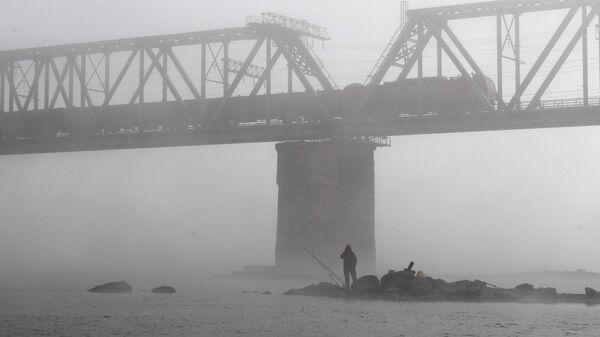 Железнодорожный мост через реку Обь, по которому проходит Транссибирская железнодорожная магистраль
