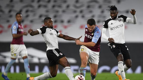 Fulham's Portuguese striker Ivan Cavaleiro (L fouls Aston Villa's Scottish midfielder John McGinn during the English Premier League football match between Fulham and Aston Villa at Craven Cottage in London on September 28, 2020. (Photo by Mike Hewitt / POOL / AFP) / RESTRICTED TO EDITORIAL USE. No use with unauthorized audio, video, data, fixture lists, club/league logos or 'live' services. Online in-match use limited to 120 images. An additional 40 images may be used in extra time. No video emulation. Social media in-match use limited to 120 images. An additional 40 images may be used in extra time. No use in betting publications, games or single club/league/player publications. /