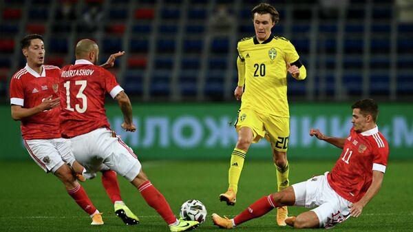 Игровой момент матча сборных России и Швеции
