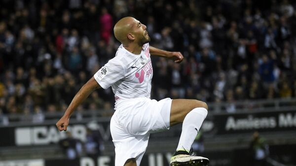 Amiens' Norwegian defender Haitam Aleesami celebrates after scoring a goal during the French L1 football match between SC Amiens and Olympique de Marseille (OM) on October 4, 2019 at the Licorne Stadium in Amiens. (Photo by FRANCOIS LO PRESTI / AFP)