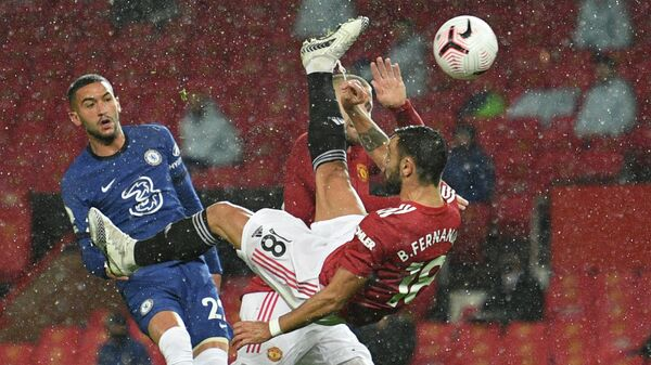 Manchester United's Portuguese midfielder Bruno Fernandes tries an overhead shot during the English Premier League football match between Manchester United and Chelsea at Old Trafford in Manchester, north west England, on October 24, 2020. (Photo by Oli SCARFF / POOL / AFP) / RESTRICTED TO EDITORIAL USE. No use with unauthorized audio, video, data, fixture lists, club/league logos or 'live' services. Online in-match use limited to 120 images. An additional 40 images may be used in extra time. No video emulation. Social media in-match use limited to 120 images. An additional 40 images may be used in extra time. No use in betting publications, games or single club/league/player publications. /