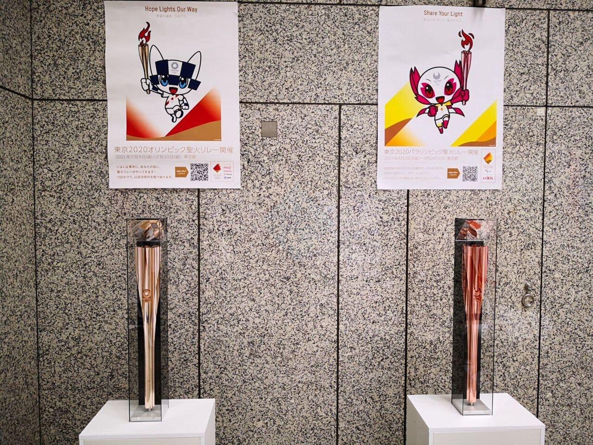 Факелы отложенных на год из-за COVID-19 Олимпиады-2020 и Паралимпийских игр в Токио  - РИА Новости, 1920, 24.05.2021