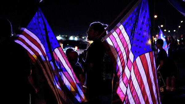 Сторонник президента Дональда Трампа во время акции протест в Лас-Вегасе