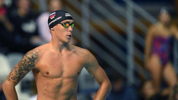 Михаил Вековищев (Россия) в соревнованиях по плаванию на дистанции 50 м баттерфляем среди мужчин на VI этапе Кубка мира по плаванию в Казани.