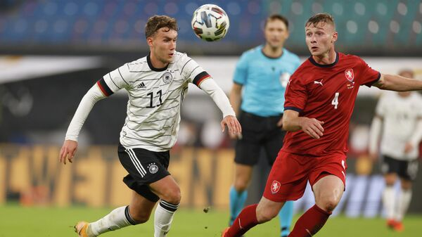 Germany's forward Luca Waldschmidt (L) and Czech Republic's defender Jakub Brabec vie for the ball during the international friendly football match Germany v Czech Republic in Leipzig, eastern Germany on November 11, 2020. (Photo by Odd ANDERSEN / AFP)