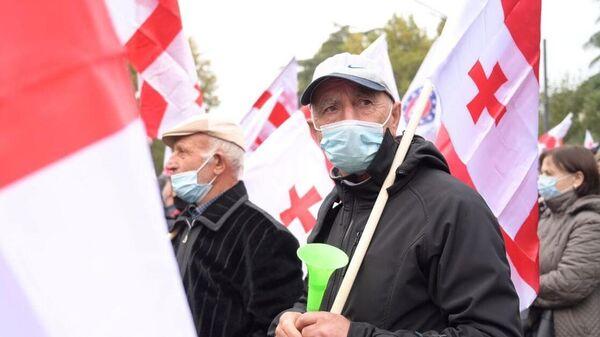 Участник акции оппозиции в Тбилиси
