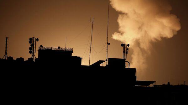 Дым после удара Израиля по сектору Газа, 22 ноября