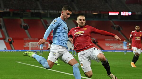 Manchester City's Spanish midfielder Ferran Torres (L) vies with Manchester United's English defender Luke Shaw (R) during the English Premier League football match between Manchester United and Manchester City at Old Trafford in Manchester, north west England, on December 12, 2020. (Photo by Paul ELLIS / POOL / AFP) / RESTRICTED TO EDITORIAL USE. No use with unauthorized audio, video, data, fixture lists, club/league logos or 'live' services. Online in-match use limited to 120 images. An additional 40 images may be used in extra time. No video emulation. Social media in-match use limited to 120 images. An additional 40 images may be used in extra time. No use in betting publications, games or single club/league/player publications. /