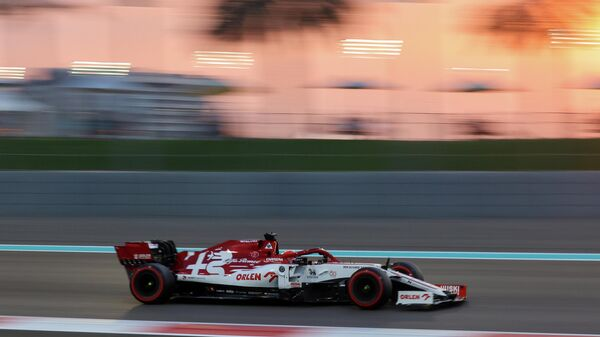 Alfa Romeo's Finnish driver Kimi Raikkonen drives during the qualifying session on the eve of the Abu Dhabi Formula One Grand Prix at the Yas Marina Circuit in the Emirati city of Abu Dhabi on December 12, 2020. (Photo by Giuseppe CACACE / POOL / AFP)