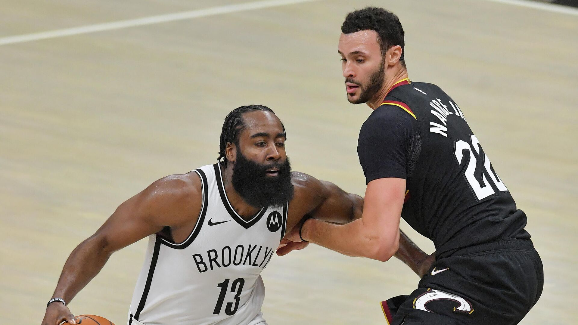 CLEVELAND, OHIO - JANUARY 20: James Harden #13 of the Brooklyn Nets drives around Larry Nance Jr. #22 of the Cleveland Cavaliers during the third quarter at Rocket Mortgage Fieldhouse on January 20, 2021 in Cleveland, Ohio. NOTE TO USER: User expressly acknowledges and agrees that, by downloading and/or using this photograph, user is consenting to the terms and conditions of the Getty Images License Agreement.   Jason Miller/Getty Images/AFP - РИА Новости, 1920, 21.01.2021