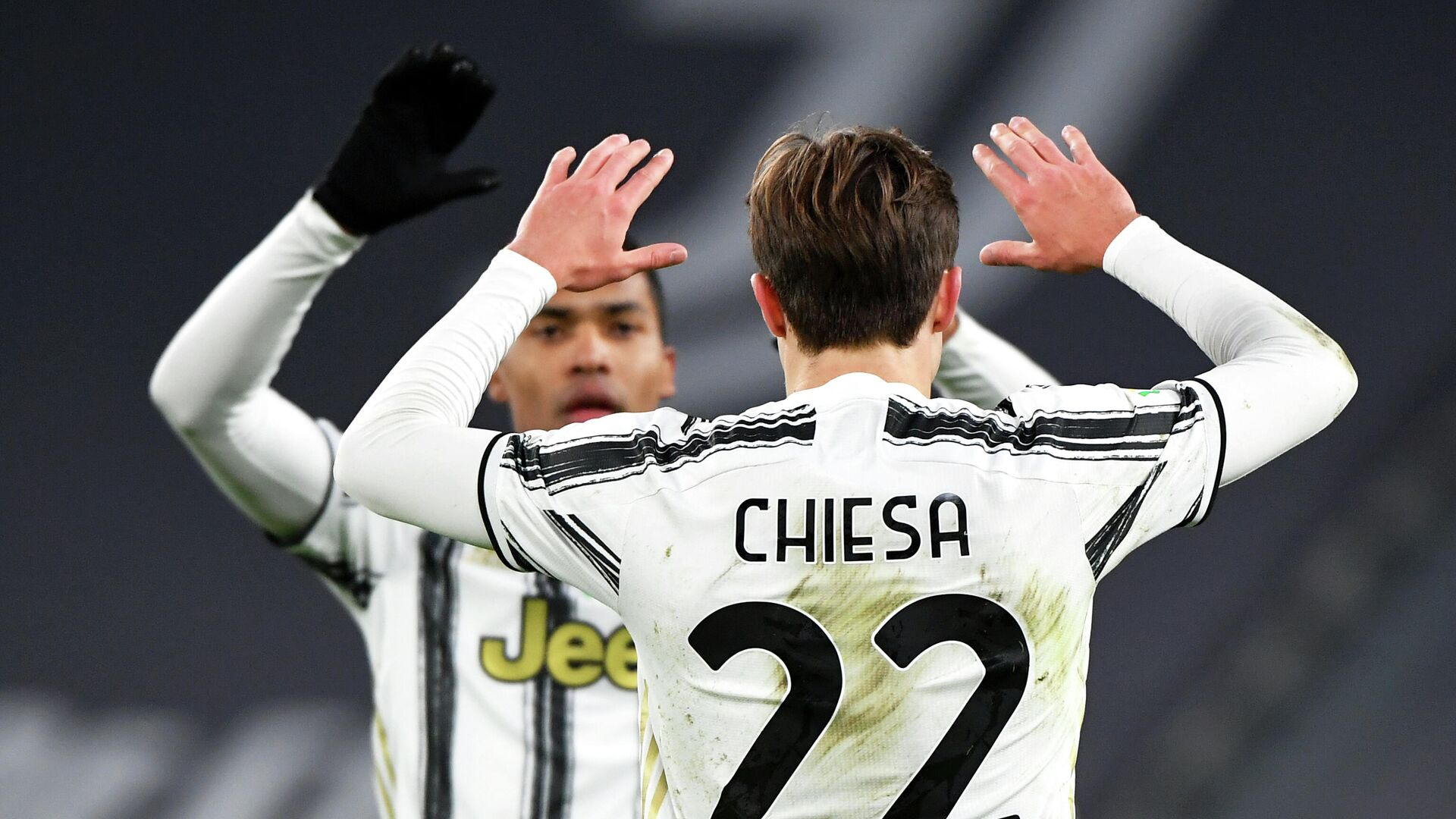 Juventus' Italian forward Federico Chiesa celebrates after scoring a goal during the Italian Cup quarter final football match beetween Juventus and Spal on January 27, 2021 at the Allianz stadium in Turin. (Photo by Isabella BONOTTO / AFP) - РИА Новости, 1920, 28.01.2021