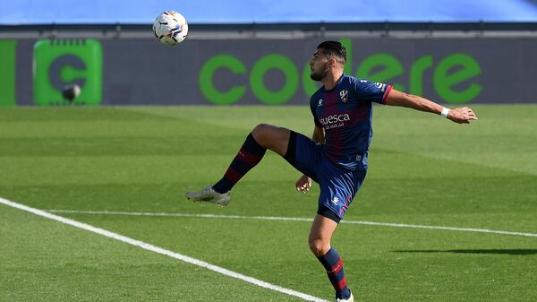 Huesca's Spanish forward Rafa Mir controls the ball during the Spanish League football match between Real Madrid and SD Huesca at the Alfredo Di Stefano stadium in Valdebebas, northeastern Madrid, on October 31, 2020. (Photo by OSCAR DEL POZO / AFP)