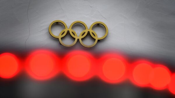 The Olympic Rings are seen at the headquarters of the International Olympic Committee (IOC) in Lausanne on February 3, 2021. (Photo by Fabrice COFFRINI / AFP)