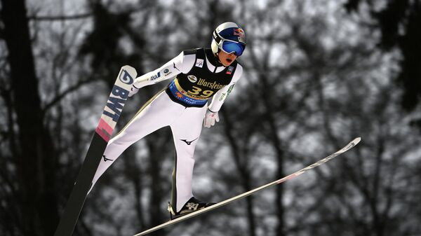 Japan's Ryoyu Kobayashi soars through the air during his first competition jump of the FIS Men's Ski Jumping World Cup in Willingen, western Germany, on January 30, 2021. (Photo by Ina FASSBENDER / AFP)