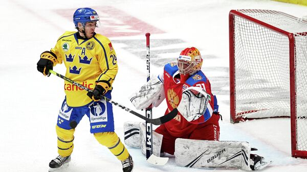 Sweden's Andreas Wingerli (L) and Russia's goalkeeper Alexander Samonov vie during the Beijer Hockey Games (Euro Hockey Tour) ice hockey match between Sweden and Russia in Malmo on February 13, 2021. (Photo by Anders Bjuro / TT NEWS AGENCY / AFP) / Sweden OUT