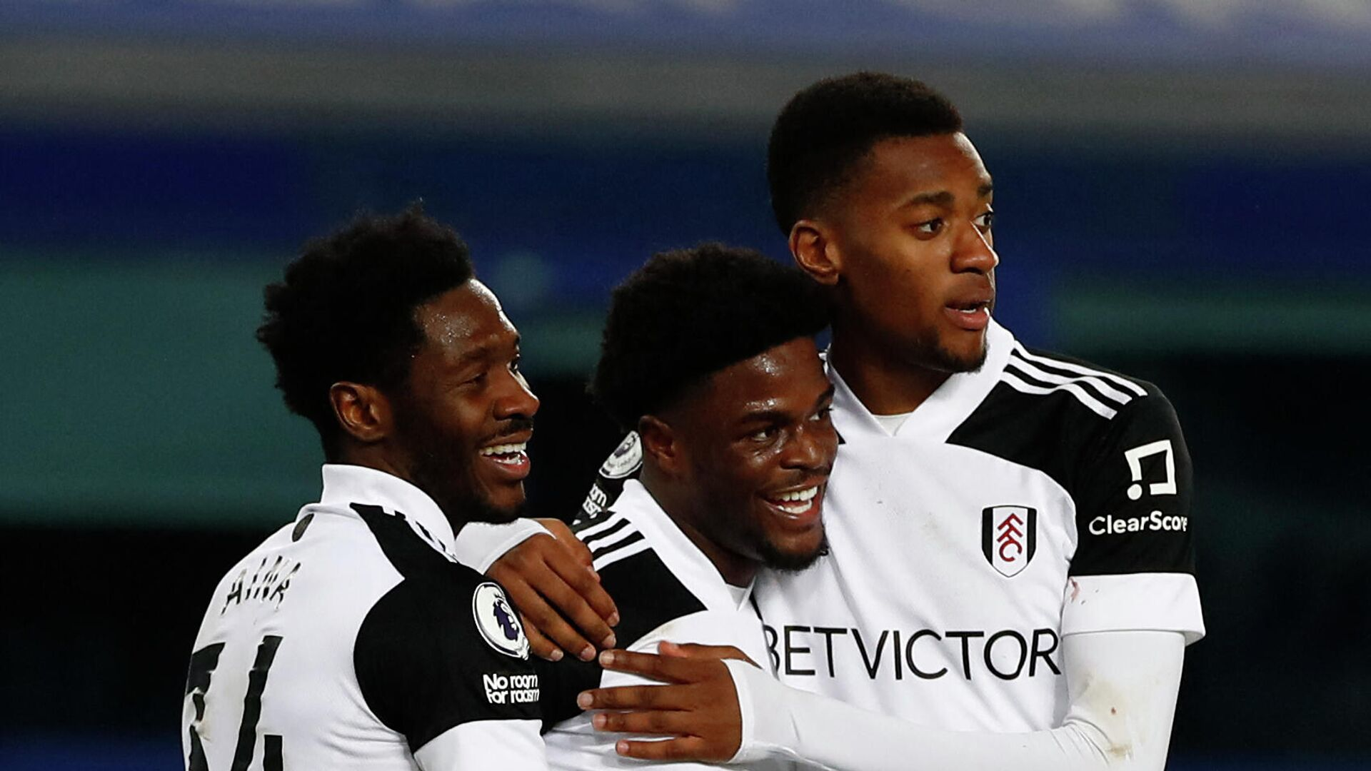 Fulham's Nigerian defender Ola Aina (L) and Fulham's English defender Tosin Adarabioyo (R) congratulate Fulham's Nigerian striker Josh Maja as he celebrates scoring his team's second goal during the English Premier League football match between Everton and Fulham at Goodison Park in Liverpool, north west England on February 14, 2021. (Photo by JASON CAIRNDUFF / POOL / AFP) / RESTRICTED TO EDITORIAL USE. No use with unauthorized audio, video, data, fixture lists, club/league logos or 'live' services. Online in-match use limited to 120 images. An additional 40 images may be used in extra time. No video emulation. Social media in-match use limited to 120 images. An additional 40 images may be used in extra time. No use in betting publications, games or single club/league/player publications. /  - РИА Новости, 1920, 15.02.2021