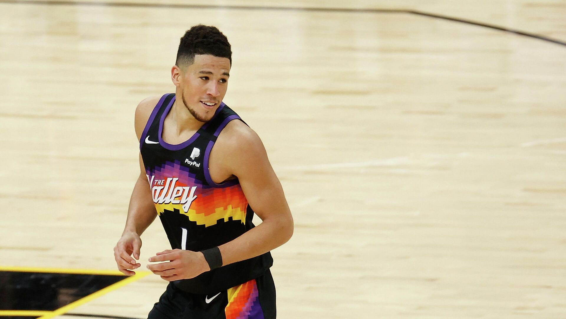 PHOENIX, ARIZONA - FEBRUARY 13: Devin Booker #1 of the Phoenix Suns reacts after a three-point shot against the Philadelphia 76ers during the second half of the NBA game at Phoenix Suns Arena on February 13, 2021 in Phoenix, Arizona. The Suns defeated the 76ers 120-111. NOTE TO USER: User expressly acknowledges and agrees that, by downloading and or using this photograph, User is consenting to the terms and conditions of the Getty Images License Agreement.   Christian Petersen/Getty Images/AFP - РИА Новости, 1920, 16.02.2021
