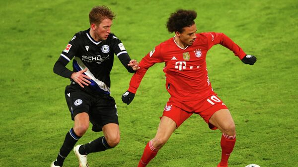 Bielefeld's Dutch forward Michel Vlap (L) and Bayern Munich's German midfielder Leroy Sane vie for the ball during the German first division Bundesliga football match FC Bayern Munich v DSC Armenia Bielefeld in Munich, southern Germany on February 15, 2021. (Photo by ADAM PRETTY / POOL / AFP) / DFL REGULATIONS PROHIBIT ANY USE OF PHOTOGRAPHS AS IMAGE SEQUENCES AND/OR QUASI-VIDEO