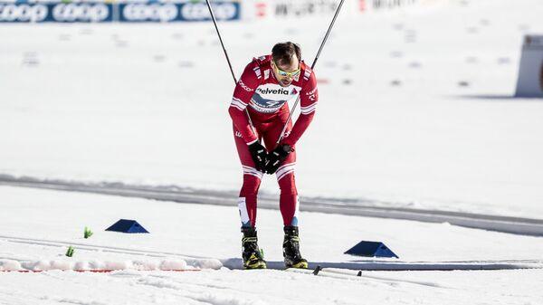 Сергей Устюгов на финише спринта свободным стилем в финале соревнований по лыжным гонкам среди мужчин на чемпионате мира-2021 по лыжным видам спорта в немецком Оберстдорфе.