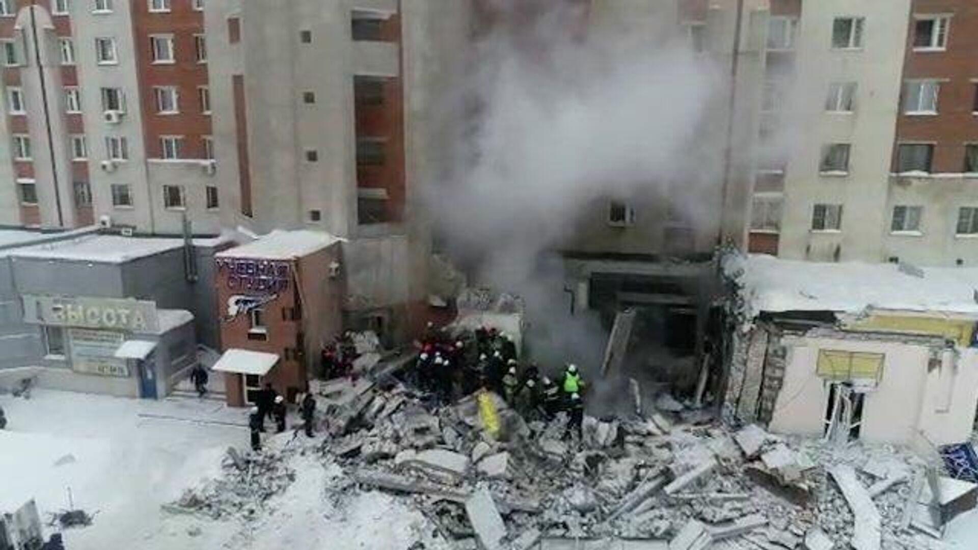 Последствия взрыва газа в Нижнем Новгороде. Кадры МЧС - РИА Новости, 1920, 26.02.2021