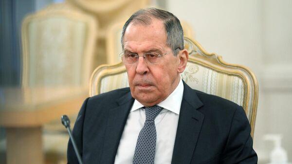 Министр иностранных дел РФ Сергей Лавров во время встречи в Москве с министром иностранных дел Афганистана Мохаммадом Ханифом Атмаром