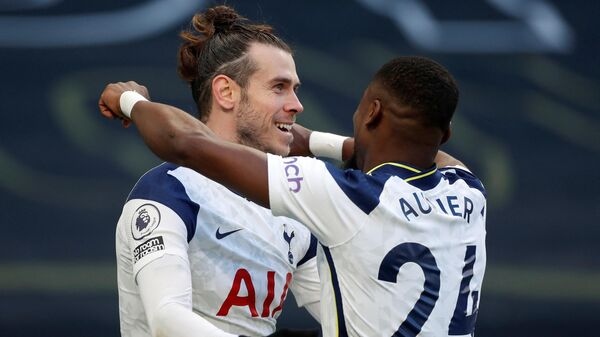 Tottenham Hotspur's Welsh striker Gareth Bale (L) celebrates scoring his team's fourth goal, his second, with Tottenham Hotspur's Ivorian defender Serge Aurier during the English Premier League football match between Tottenham Hotspur and Burnley at Tottenham Hotspur Stadium in London, on February 28, 2021. (Photo by MATTHEW CHILDS / POOL / AFP) / RESTRICTED TO EDITORIAL USE. No use with unauthorized audio, video, data, fixture lists, club/league logos or 'live' services. Online in-match use limited to 120 images. An additional 40 images may be used in extra time. No video emulation. Social media in-match use limited to 120 images. An additional 40 images may be used in extra time. No use in betting publications, games or single club/league/player publications. /
