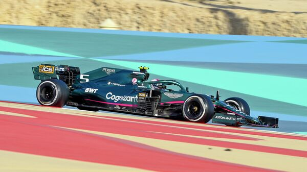 Aston Martin's German driver Sebastian Vettel drives during the third day of the Formula One (F1) pre-season testing at the Bahrain International Circuit in the city of Sakhir on March 14, 2021. (Photo by Mazen MAHDI / AFP)